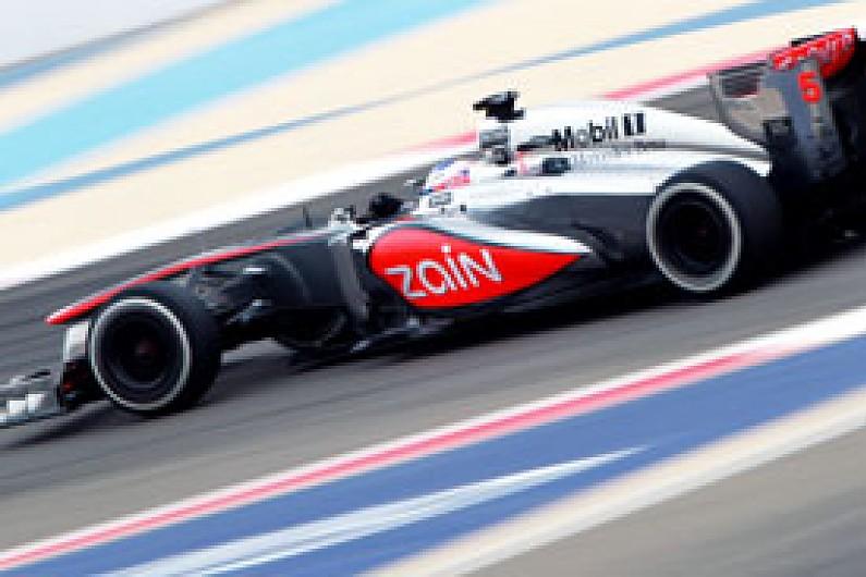 mclaren refuses to switch focus to 2014 f1 car despite poor start